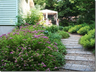 Deck Border as seen entering the garden from the driveway (photo credit: Jean Potuchek)