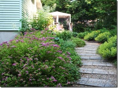 Deck Border as seen entering the garden from the driveway (photo credit: Jean Potuchek)